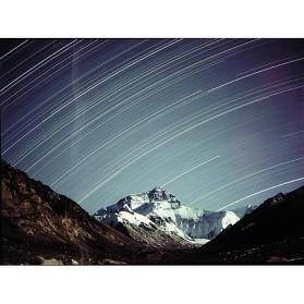 The North Face of Mount Everest, by Moonlight, with Star Tracks